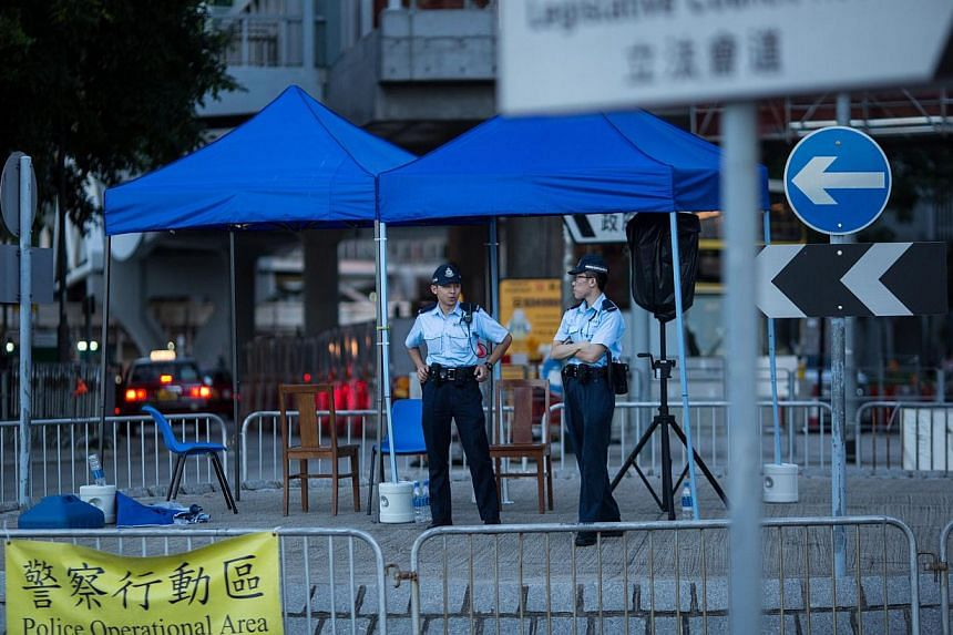 Police stand guard by a roundabout outside the Legislative Council in Hong Kong, China, on June 15, 2015. -- PHOTO: EPA