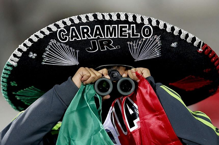 Mexican National football team supporters prior to the Copa America 2015 Group A football match between Chile and Mexico, at Estadio Nacional Julio Martinez Pradanos in Santiago de Chile, Chile. -- PHOTO: EPA
