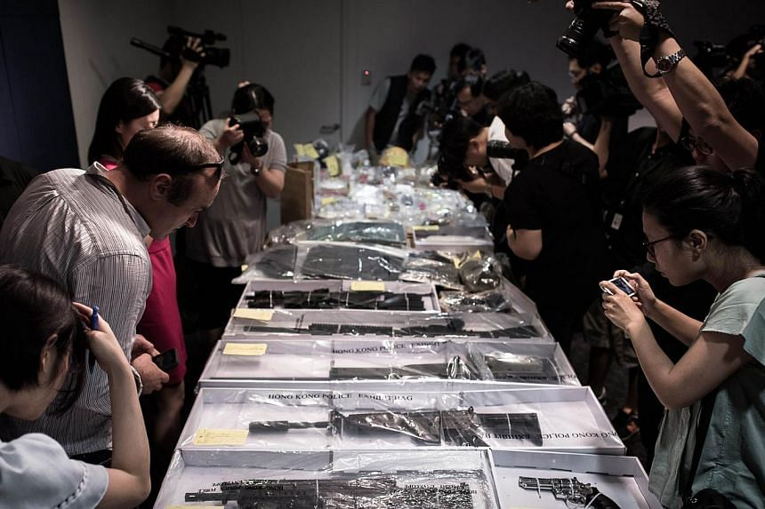 Air rifles and other seized items are displayed before a press conference at the police headquarters in Hong Kong on June 15, 2015, after suspected explosives were seized at an abandoned television studio in the east coast district of Sai Kung. -- PH
