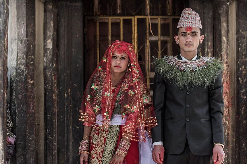 Nepalese couple Anita Thapa, 22, and Sagar KC, 24, at their wedding on May 3 in Kathmandu, which was postponed after the 7.8 magnitude quake on April 25. The disaster made fulfilling nuptial rituals easier, as the need to spend lots of money and fulf