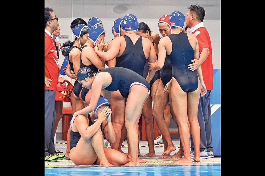 The Singapore women's water polo team, who were the defending champions, suffered a shock 4-5 loss to Thailand yesterday. -- ST PHOTO: CHONG JUN LIANG