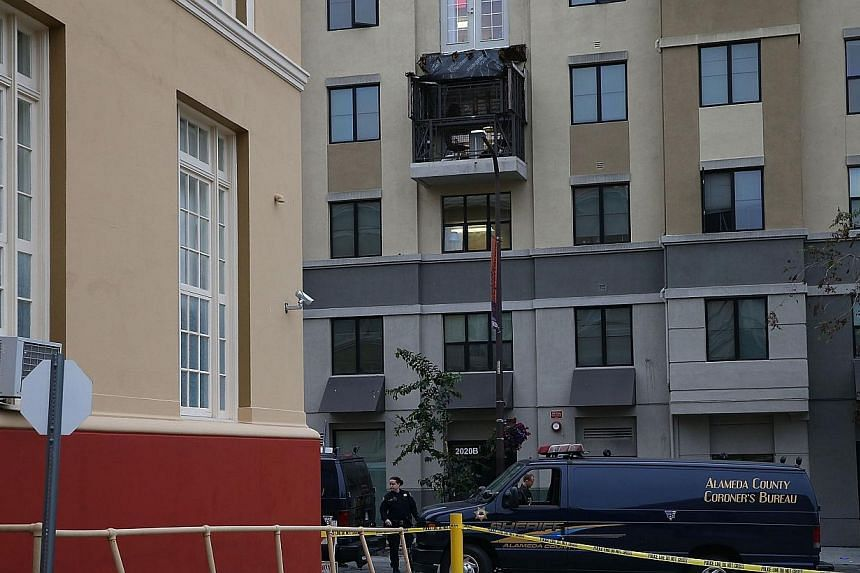 A coroner's vehicle sits parked at the scene of a balcony collapse at an apartment building near UC Berkeley on June 16, 2015, in Berkeley, California. -- PHOTO: AFP