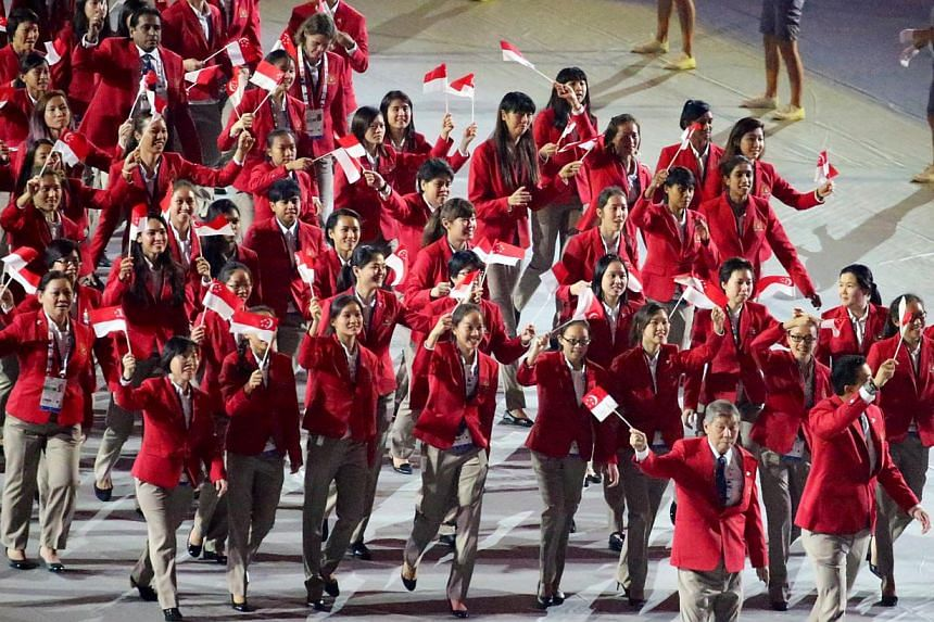 The Singapore contingent marching past during the opening ceremony of the 28th SEA Games at the Singapore Sports Hub on June 5, 2015. -- PHOTO: THE NEW PAPER