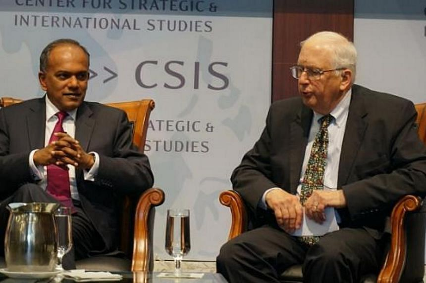 Singapore Foreign Minister K. Shanmugam (left) answering questions from prominent US diplomat Stapleton Roy during a forum at the Centre for Strategic and International Studies in Washington on Monday. -- PHOTO: JEREMY AU YONG