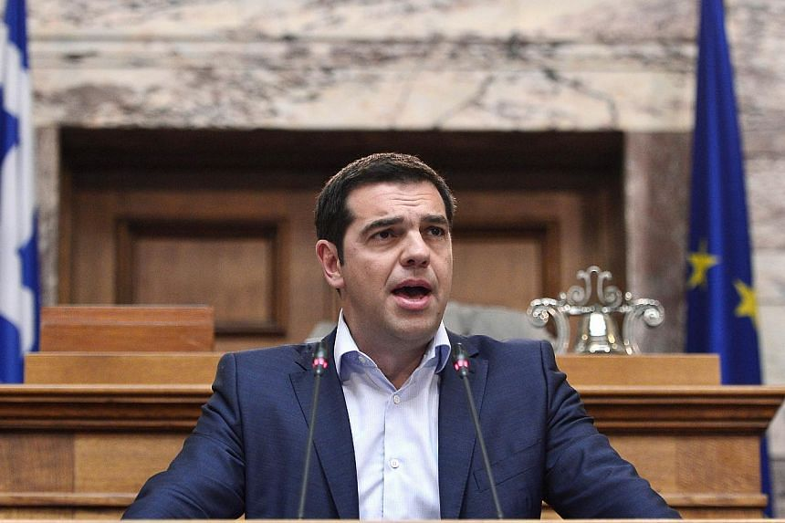 Greek Prime Minister Alexis Tsipras addresses his MP's and ministers at the Greek Parliament in Athens on June 16, 2015. -- PHOTO: AFP
