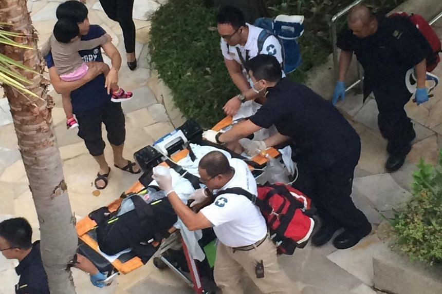 Medics attend to a seven-year-old boy rescued from a swimming pool at Resorts World Sentosa. He was later pronounced dead at Singapore General Hospital. -- PHOTO: WAN BAO
