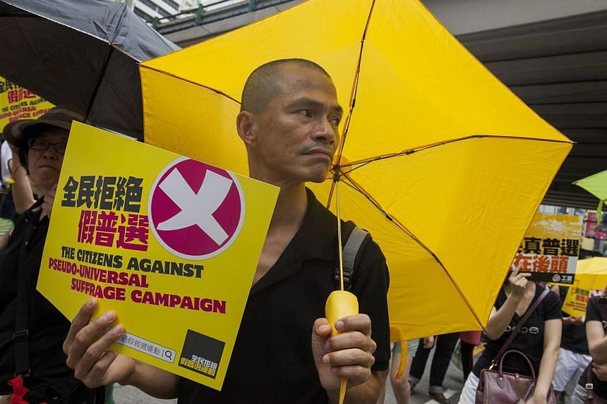 Supporters of real universal suffrage in Hong Kong march through the city streets for the last time ahead of a crucial vote on political reform in the city's Legislative Council, due to take place on 17 or 18 June, in Hong Kong, China, on June 14, 20