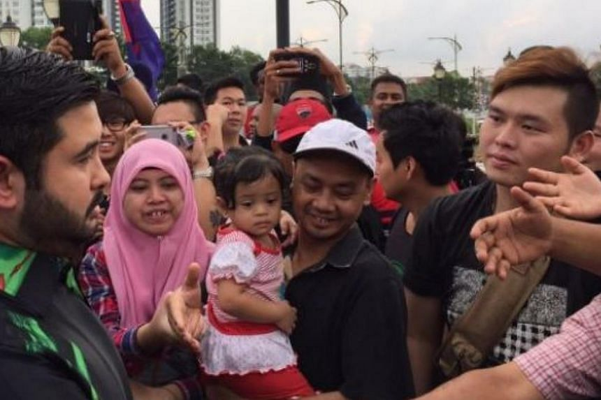 Crown Prince Tunku Ismail Sultan Ibrahim (left), mingling with the crowd that has shown up in support of the Johor Royalty at the Bukit Serene Royal Palace in Johor Baru on June 16, 2015. -- PHOTO: THE STAR