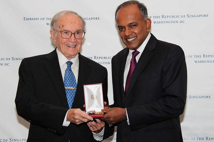Minister K Shanmugam (right) presenting the Public Service Star (Distinguished Friends of Singapore) to Singapore's Honorary Consul-General in Chicago Newton Minow, on June 15, 2015. -- PHOTO: MINISTRY OF FOREIGN AFFAIRS