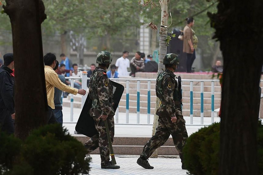 Paramilitary police patrolling beside the central square in Hotan, in China's western Xinjiang region, on April 16, 2015.Some local governments in China's unruly far western region of Xinjiang are stepping up controls on the Islamic faith follo