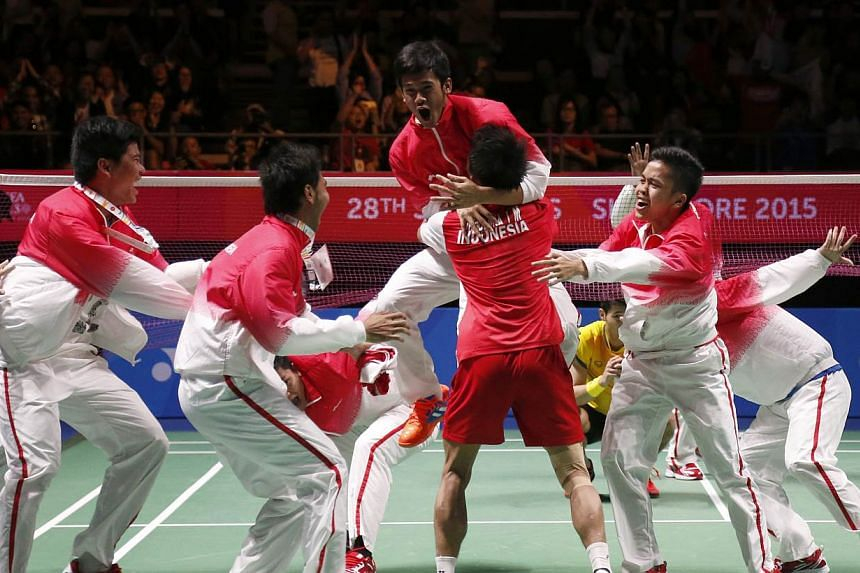 The Indonesia team celebrating on court after they beat Thailand in the badminton men's team final on June 12, 2015. -- PHOTO: SINGAPORE SEA GAMES ORGANISING COMMITTEE/ACTION IMAGES VIA REUTERS