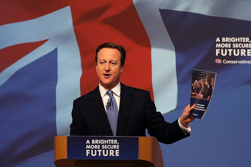 Britain's Prime Minister and leader of the Conservative Party, David Cameron, unveils his party's general election manifesto in Swindon, southern England, on April 14, 2015.Mr Cameron has performed a U-turn and ruled out holding a European Unio