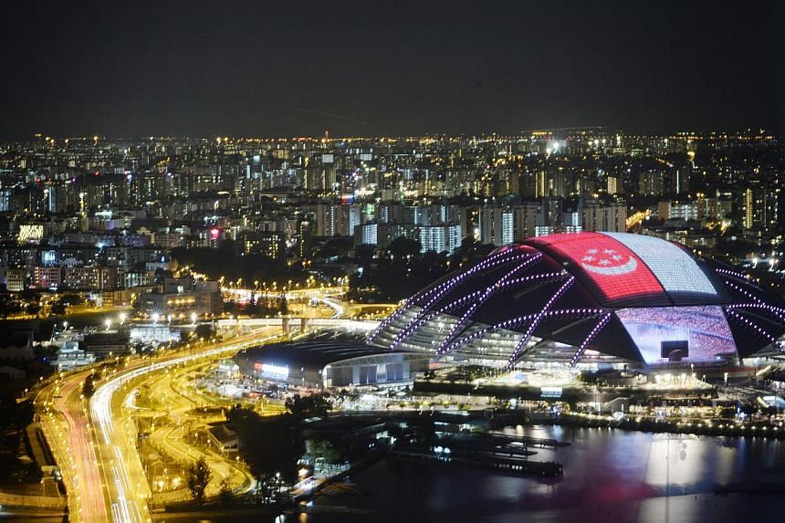 A giant Singapore flag on the roof of the Sports Hub during the 28th SEA Games Opening Ceremony held at the National Stadium on June 5, 2015. -- ST PHOTO: MARK CHEONG