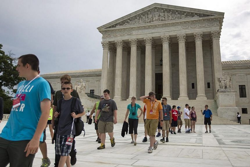 Tour groups visit the Supreme Court in Washington, DC on Monday. -- PHOTO: EPA