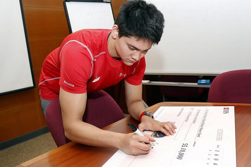 Singapore swimmer Joseph Schooling, who won nine golds in nine events at the 2015 SEA Games, donated $10,000 to charity on Tuesday morning.-- ST PHOTO: KEVIN LIM