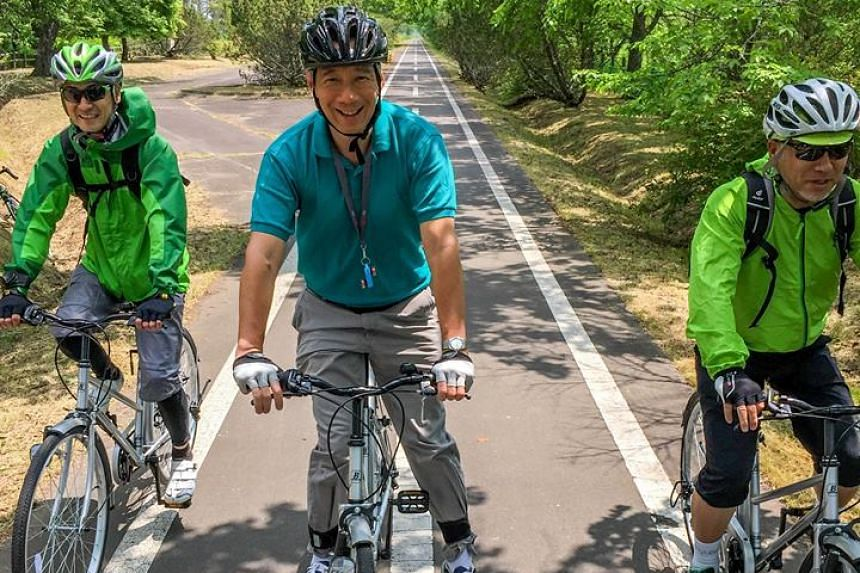 Prime Minister Lee Hsien Loong cycling in Kushiro, Japan.