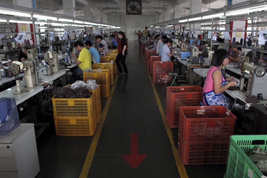 A shoe factory in Putian, Fujian province. China's manufacturing output rose by a better-than-expected 6.1 per cent last month from 5.9 per cent in April.