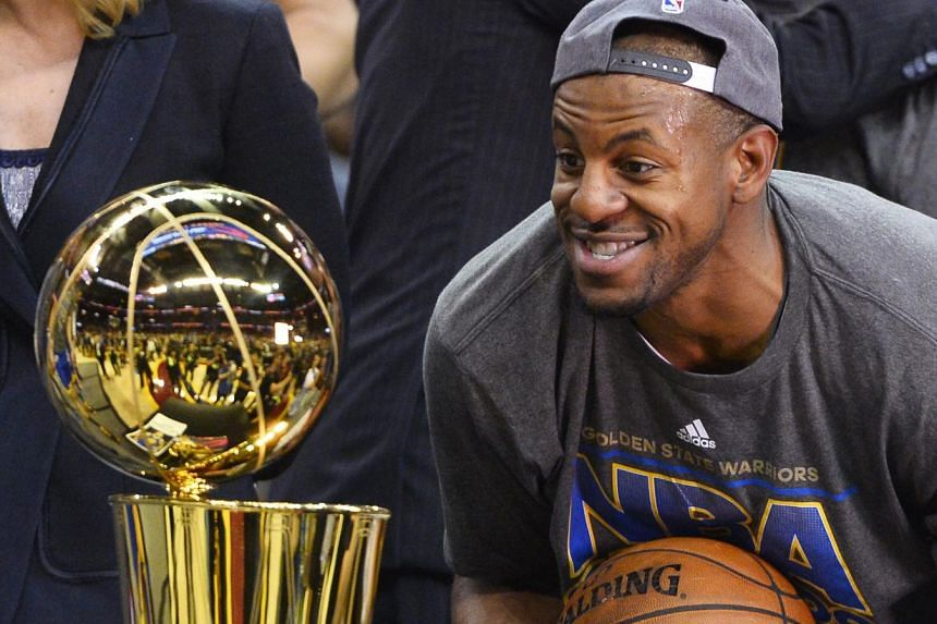 Golden State Warriors' Andre Iguodala with the NBA Finals trophy after Game 6.