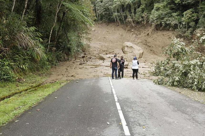 A road leading to the Mesilau Nature Centre damaged by the mudflow, which began at about 3pm on Monday, blocking roads and seriously damaging bridges.