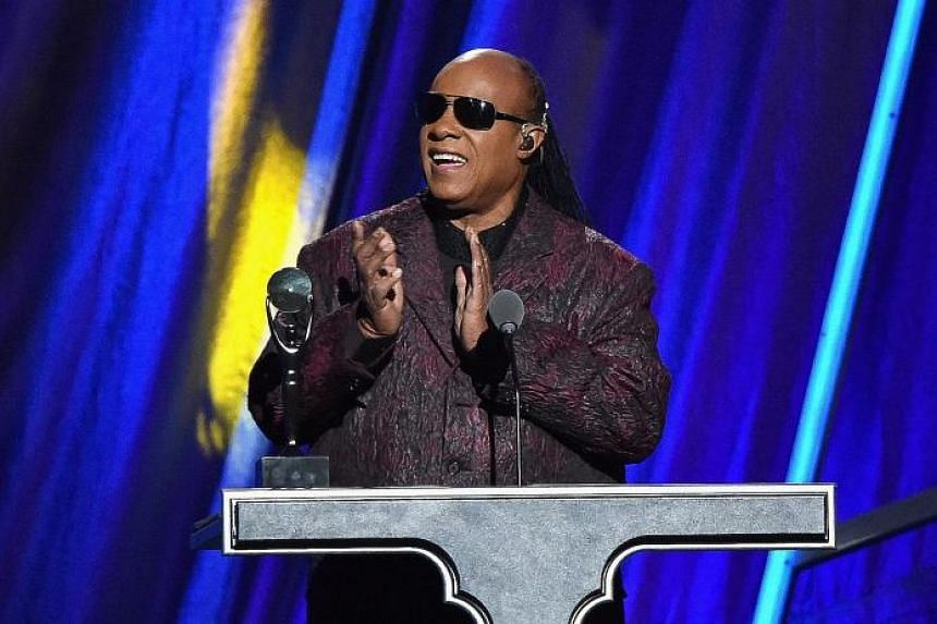 Singer Stevie Wonder (left) performed for about 500 guests at the White House last Saturday.