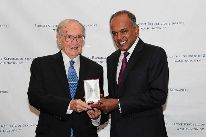 Mr K. Shanmugam (right) presenting the Public Service Star (Distinguished Friends of Singapore) to Mr Newton Minow.