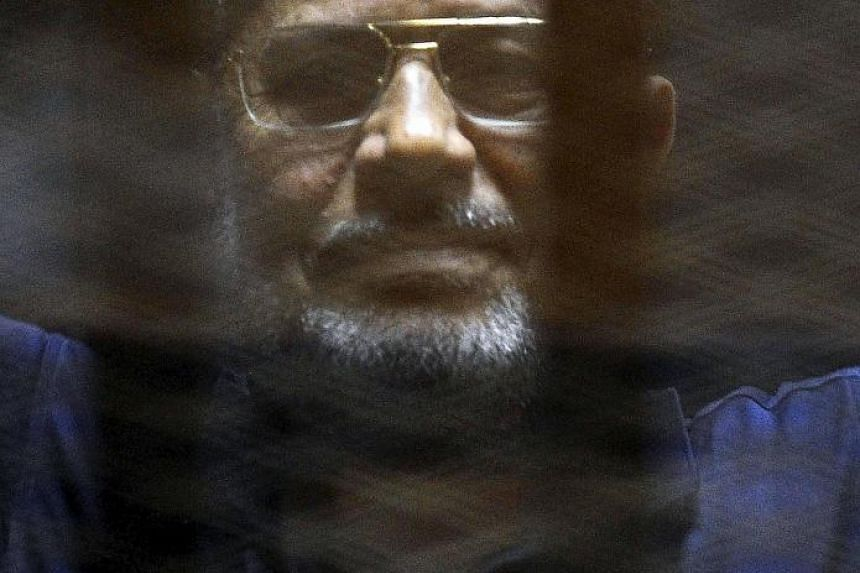 Mohamed Mursi in court yesterday. He had been convicted of killing and kidnapping policemen, and jailbreak.