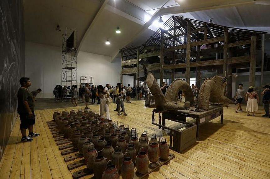 Ai Weiwei's first solo exhibition in Beijing includes a 400-year-old wooden ancestral hall (above, background).