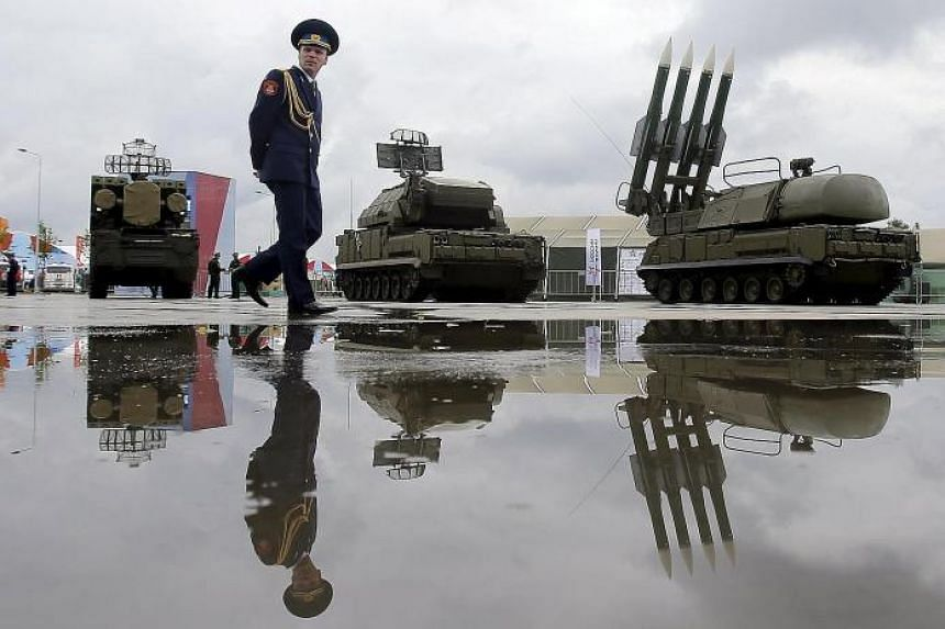 The Buk-1M missile system at a military and arms fair in Kubinka, outside Moscow, yesterday. Russia's Deputy Defence Minister Anatoly Antonov has accused Nato of provoking a new arms race.