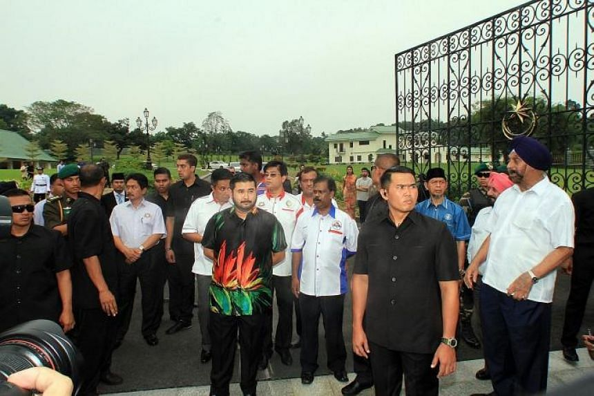 Crown Prince Tunku Ismail (left) outside Bukit Serene Royal Palace in Johor Baru where a rally was held yesterday.