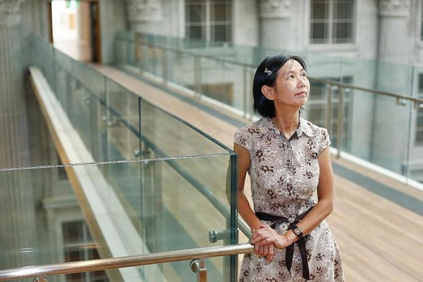 Volunteer guide Tan Hui Kheng says that the National Gallery is impressive even without the artworks. One of the highlights of the new building is the roof, made of 15,000 aluminium panels in shades of gold that extends from the old Supreme Court bui