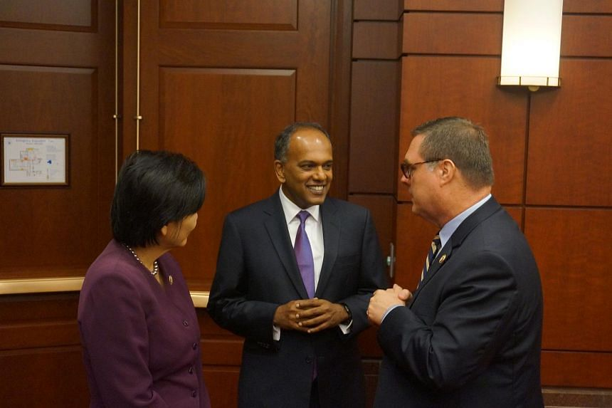 Singapore Foreign Minister K. Shanmugam (centre) with Singapore caucus co-chair Denny Heck (right) and Representative Judy Chu (left), the chair of the Asian Pacific American Caucus.