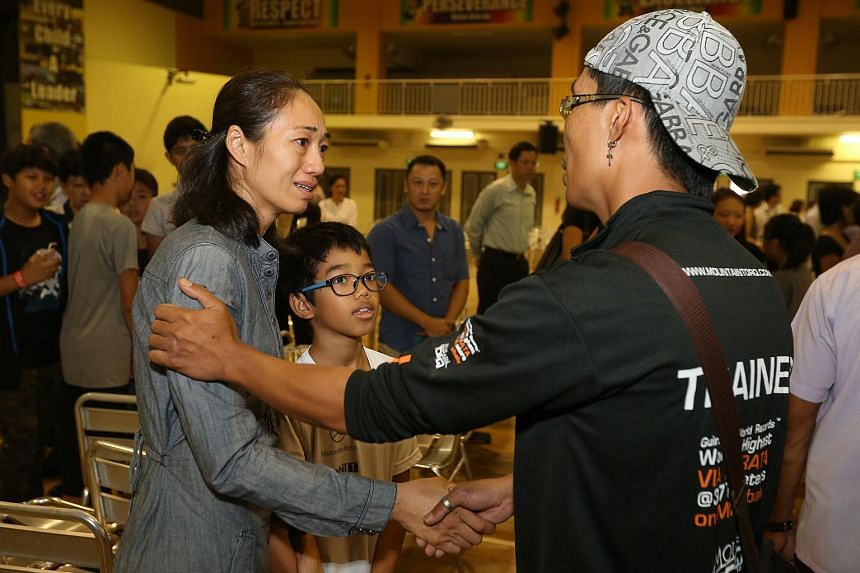 Mountain Torq trainer Hillary Augustinus (right) speaking with Ms Vu Thi Thanh (left) and Andrew Mathieu Giovanna Ramu,  the mother and younger brother of the deceased Emilie Giovanna Ramu, at the school on Wednesday, June 17, 2015.