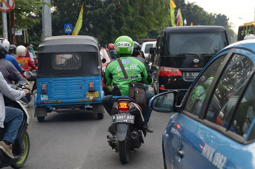 A motorcycle driver from Indonesian start-up Go-Jek on a street in Jakarta.