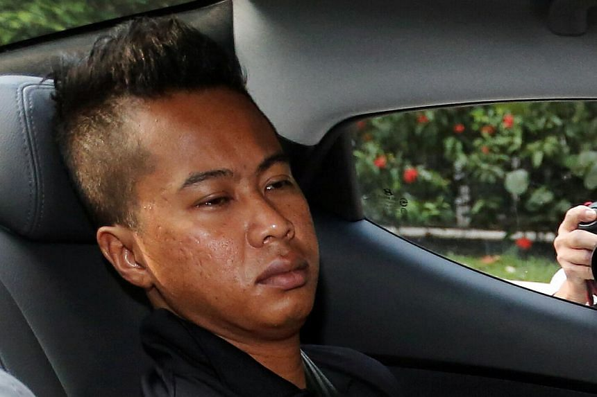 Loanshark runner Mohamed Ashyik Mohamed Shawal, 31, is accused of setting fire to two Toh Guan road flats.