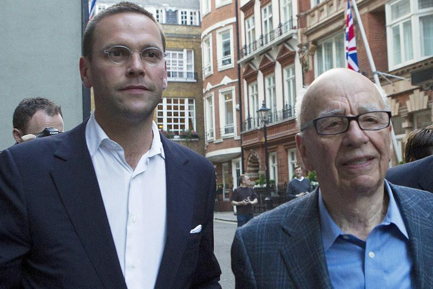James Murdoch (left) and his father Rupert leaving the Stafford Hotel in central London on July 10, 2011.