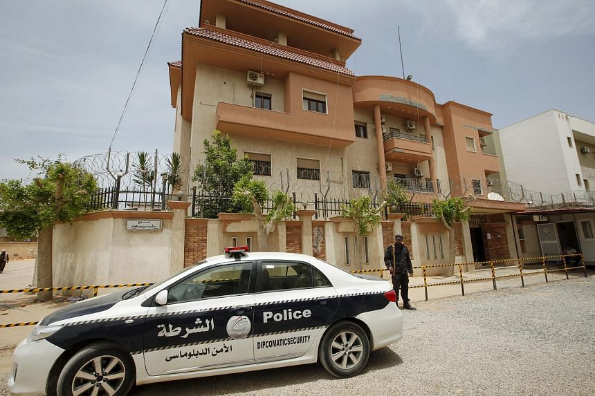 A police vehicle is seen parked in front of the Tunisian consulate in Tripoli, Libya on June 13, 2015.