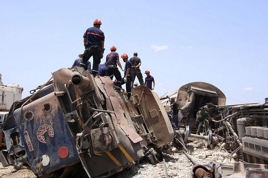 Rescuers working at the site of the collision.