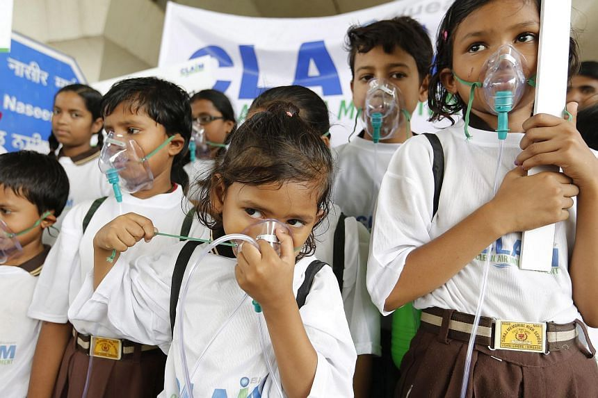 Indian school children  wear oxygen masks to raise awareness regarding the dangers of air pollution organised by Clean Air India Movement (CLAIM).
