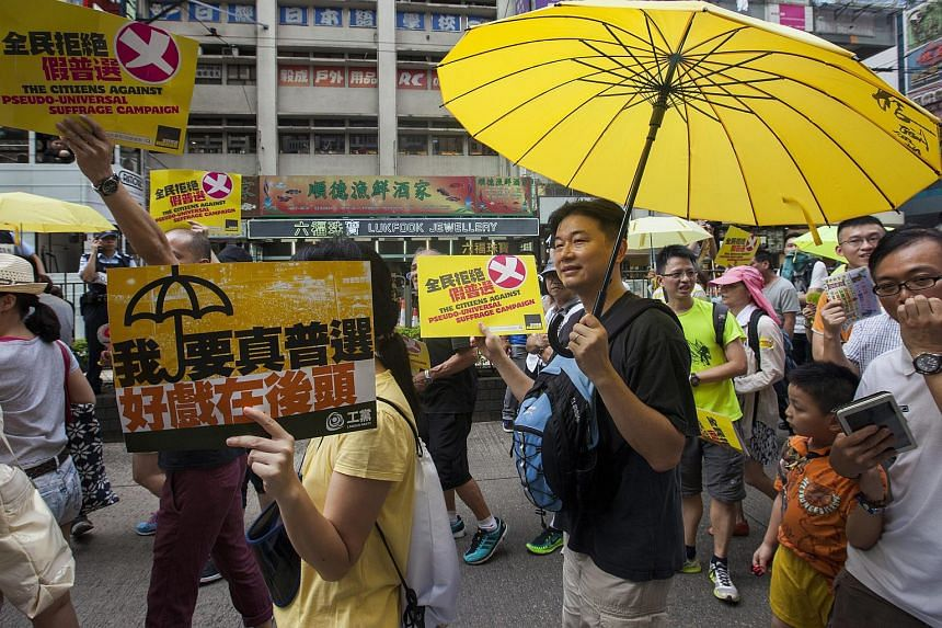 Supporters of universal suffrage in Hong Kong marching on June 14, 2015, ahead of a crucial vote on political reform.
