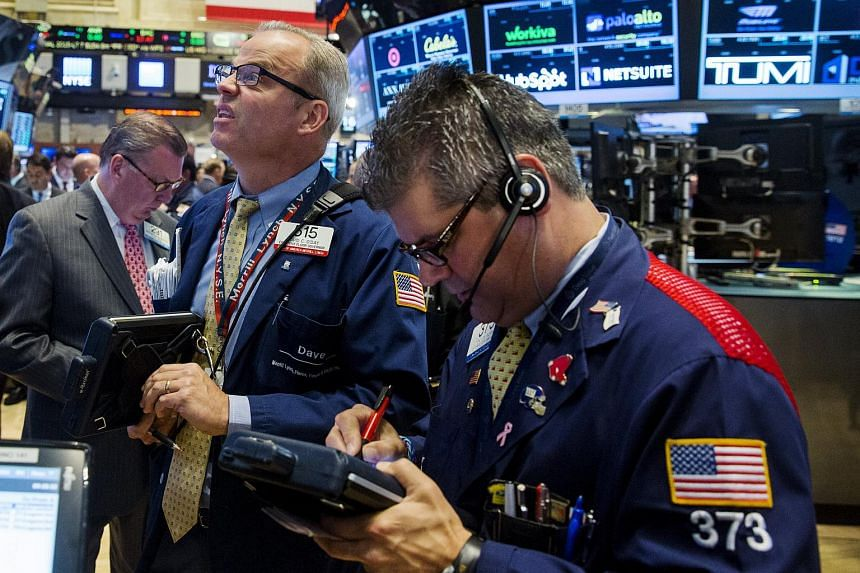 Traders working on the floor of the New York Stock Exchange.