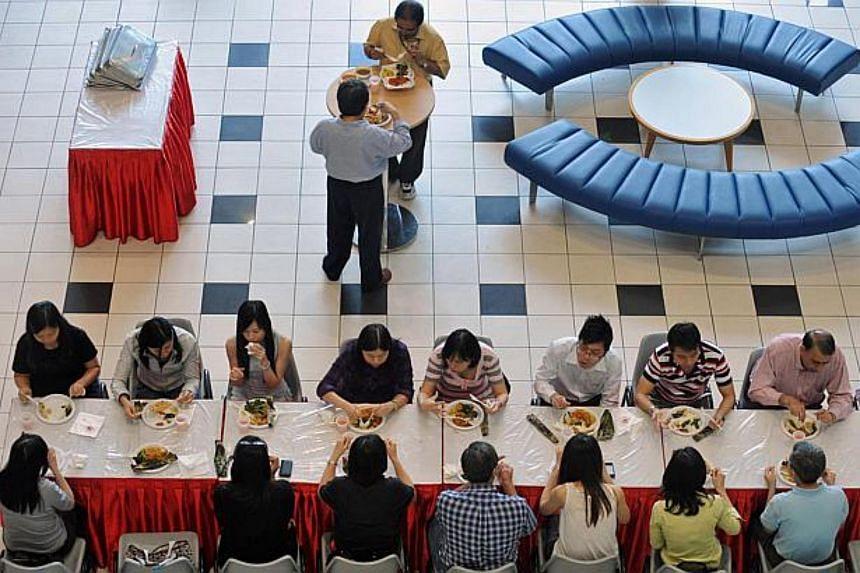 Civil servants dining at the Civil Service College's (CSC) atrium.