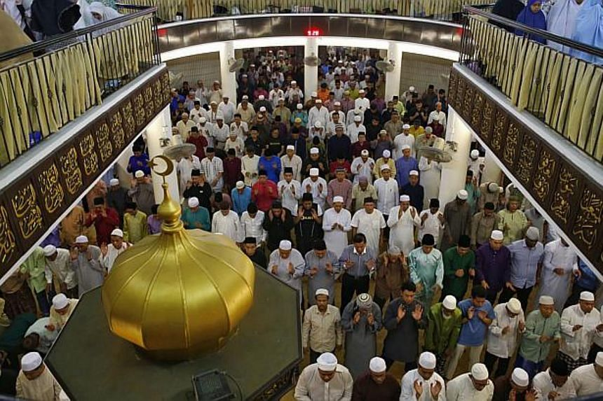 Some 2,500 Muslims performing special prayers on the eve of the first day of Ramadan at Al-Mukminin Mosque in Jurong East.
