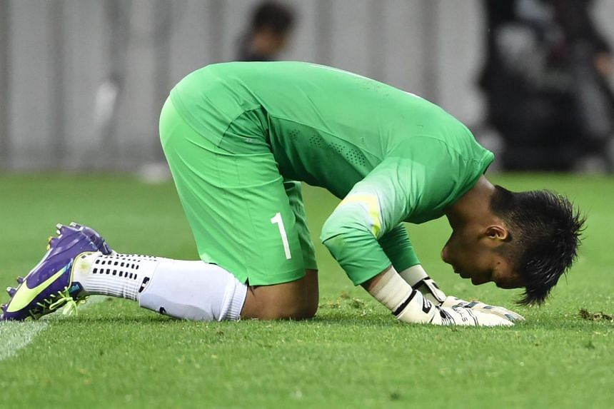 Izwan after the 0-0 draw against Japan in Saitama. He made 18 saves in total.