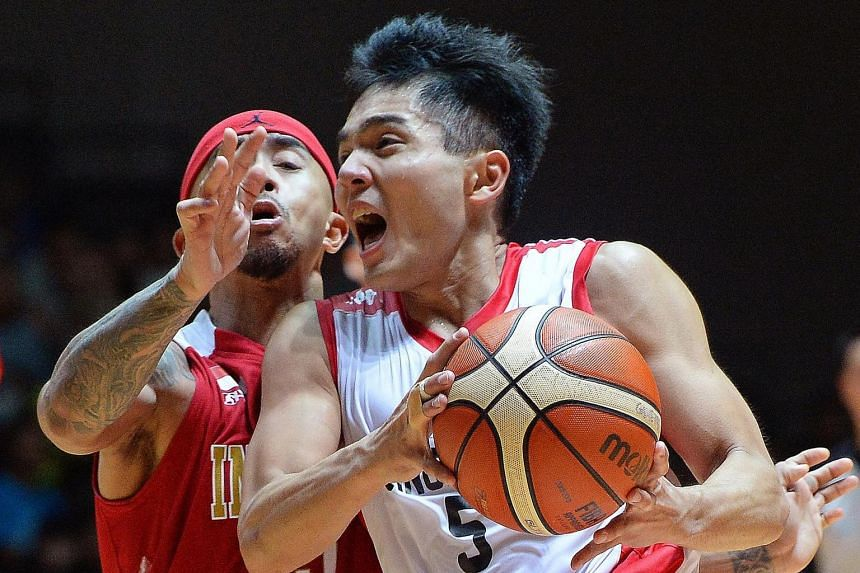 Basketballer Wong Wei Long (in white) had to juggle studies as well as training.