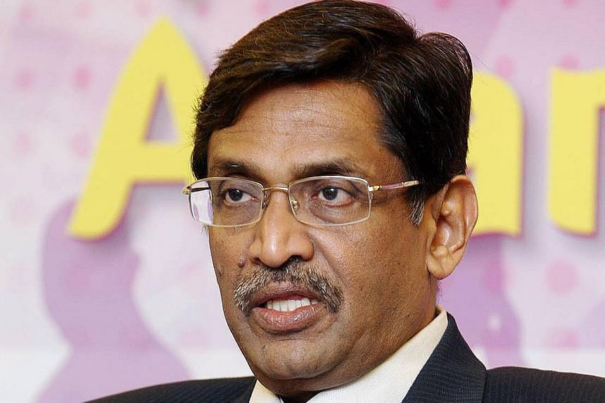 Hours after MIC president G. Palanivel (left) announced his deputy's suspension, Datuk Seri S. Subramaniam declared that he was taking over as acting president