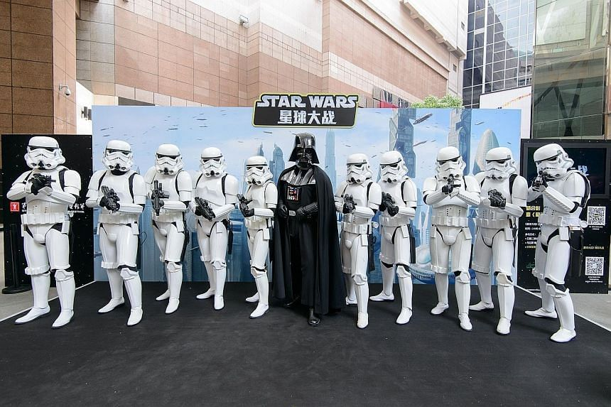 Taking China by storm... Star Wars characters Darth Vader and StormTroopers at the Shanghai International Film Festival this week.