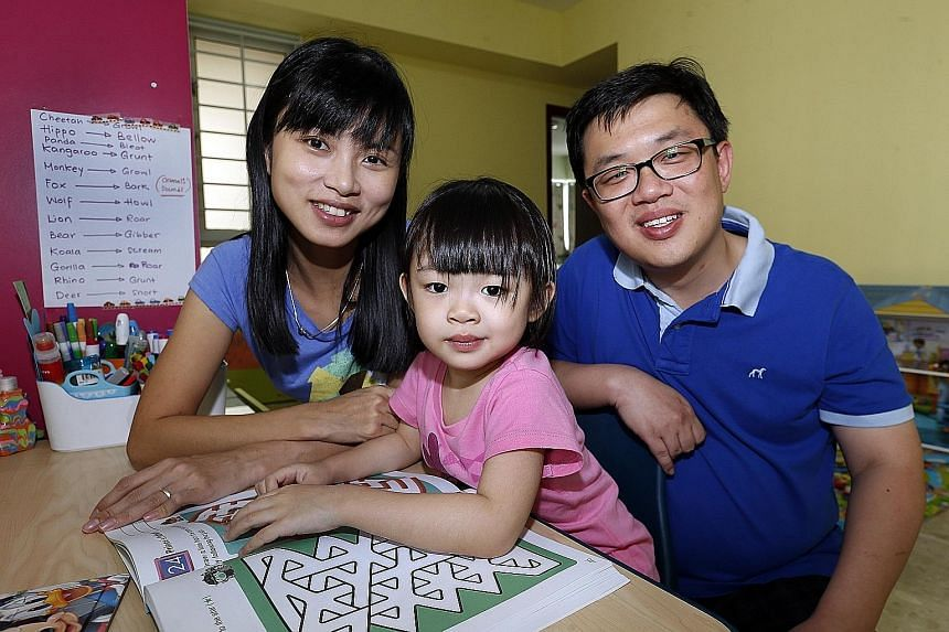 Renae, who turns five in August, with her parents, Mr Tong Peng Geat and Ms Ray Khorsuk. She was tested at three and found to have an IQ of 140. An average child's IQ is 100. Tricia, who turns four this year, with her parents, Mr Loke Chok Loon and M