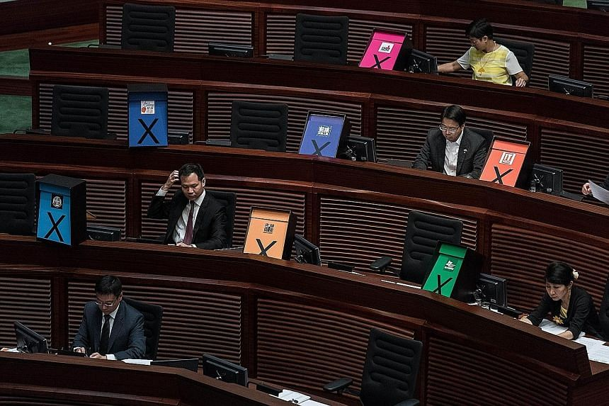 Placards symbolising a vote against the government's controversial electoral road map in Hong Kong's legislature yesterday.