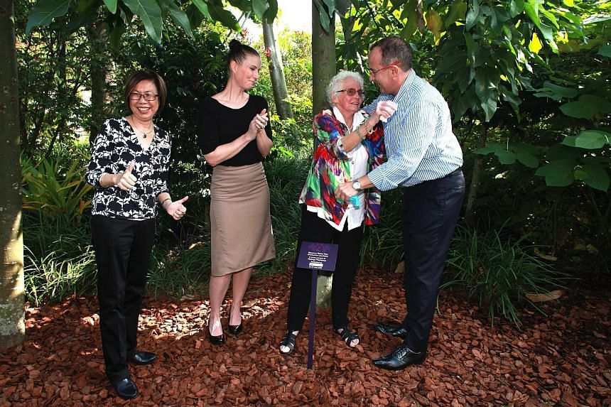 (From left) Gardens by the Bay deputy chief executive Peggy Chong; Australian High Commission second secretary Clele White; Mrs Finette Psarianos, and her son, Andrew, who adopted the tree (right).