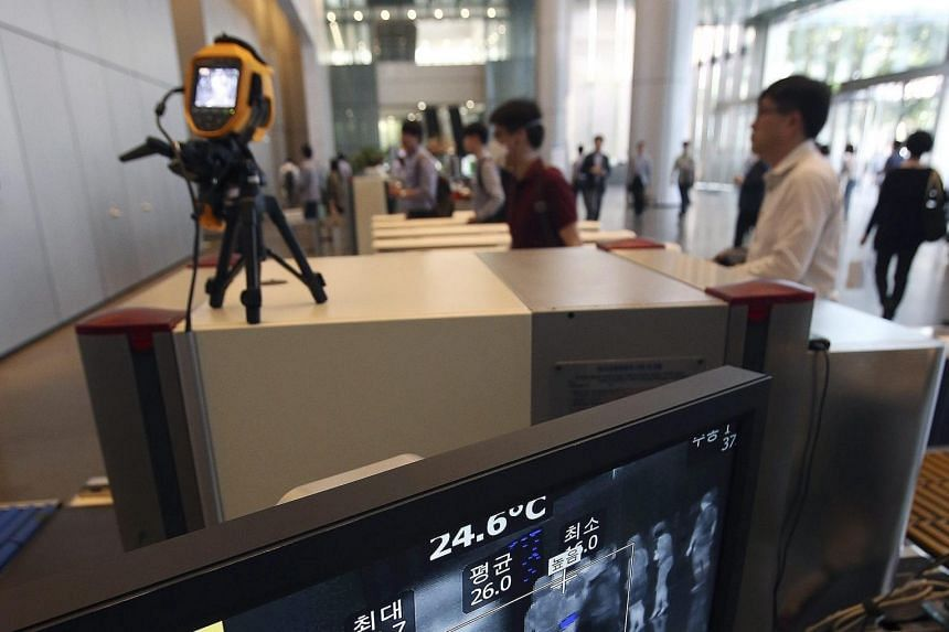 A thermal camera installed at the offices of Samsung Electronics in Seoul as a precaution against the spread of the Middle East respiratory syndrome. South Korea reported eight new cases yesterday.